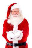 Santa Claus holding something Royalty Free Stock Image