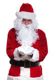 Santa claus is holding something on his hands Stock Photos