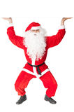 Santa Claus holding something over head Royalty Free Stock Image