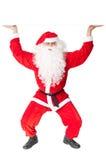 Santa Claus holding something over head. Isolated on white background royalty free stock image