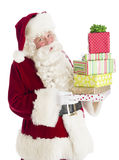 Santa Claus Holding Stack Of Gift Boxes Stock Images