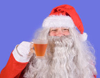 Santa Claus holding a teacup Royalty Free Stock Images