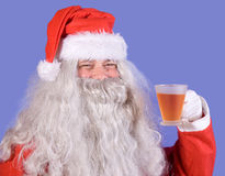Santa Claus holding a teacup Royalty Free Stock Photo