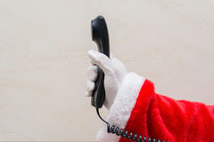 Santa Claus holding telephone receiver Royalty Free Stock Image