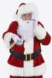 Santa Claus Holding Television Remote Control imagen de archivo libre de regalías