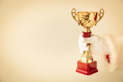 Santa Claus holding trophy Stock Photo