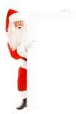Santa Claus Holding um espaço de propaganda Fotografia de Stock