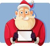Santa Claus Holding un dibujo del vector de la tableta de la PC Fotografía de archivo