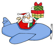 Santa claus holding up a stack his christmas plane Stock Images