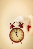 Santa Claus holding vintage alarm clock Royalty Free Stock Photos