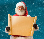 Santa Claus holding vintage paper blank sign Royalty Free Stock Photo