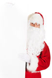 Santa Claus holding white blank sign. Santa Claus holding empty banner Royalty Free Stock Images