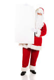 Santa Claus holding white blank sign. Santa Claus holding empty banner royalty free stock photo