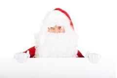 Santa Claus holding white blank sign. Santa Claus holding empty banner stock photos