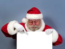 Santa Claus holding white board royalty free stock photography
