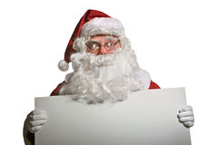 Santa Claus holding the  white panel Stock Images