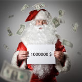 Santa Claus is holding a white paper in his hands. One million d. Ollars concept Stock Images