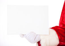 Santa Claus holding white sign Stock Photo