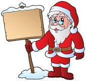 Santa Claus holding wooden board Stock Photos