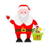 Santa Claus holds a basket of of food Royalty Free Stock Images