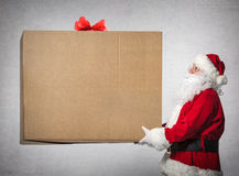 Santa Claus holds big gift box Royalty Free Stock Photography