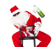 Santa Claus holds bottle of champagne Royalty Free Stock Photography