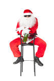 Santa Claus holds a bottle of champagne Royalty Free Stock Images