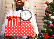 Santa Claus holds gifts. Guys hands with New Year attributes royalty free stock image