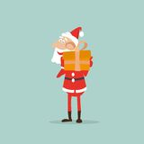 Santa Claus holds in his hands a box with a gift Stock Image