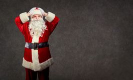 Santa Claus holds his head in his hands. royalty free stock images