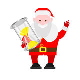 Santa Claus holds an hourglass Stock Photos