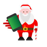 Santa Claus holds a mobile phone Stock Photo