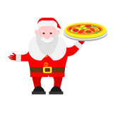 Santa Claus holds a pizza Stock Photo