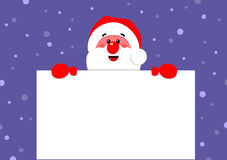 Santa Claus holds a poster Stock Images