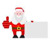 Santa Claus holds a presentation card Royalty Free Stock Photo
