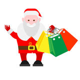 Santa Claus holds shopping bags Stock Image