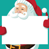 Santa Claus holds your message on a placard. Royalty Free Stock Photography