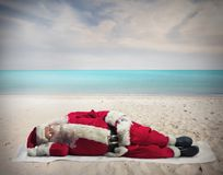 Santa Claus holiday. Santa Claus sleeping at the hot beach royalty free stock photography