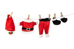 Santa Claus holiday suit hanging on clothesline. Stock Photo