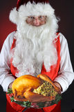 Santa Claus With Holiday Turkey Arkivbilder