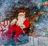 Santa Claus in home interior Stock Images