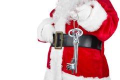 Santa Claus with home key Royalty Free Stock Photos