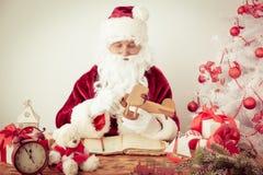Santa Claus at home Stock Images