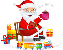 Santa Claus with a hot tea and cookies Stock Image