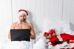Santa getting ready for Christmas Royalty Free Stock Photos