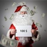 Santa Claus houdt een Witboek in zijn handen Honderd D Royalty-vrije Stock Foto