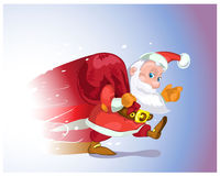 Santa Claus hurries from the travel with gifts. Stock Photo