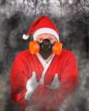 Santa Claus i gasmask Arkivbild