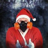 Santa Claus i gasmask Fotografering för Bildbyråer