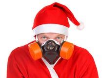 Santa Claus i gasmask Royaltyfri Bild